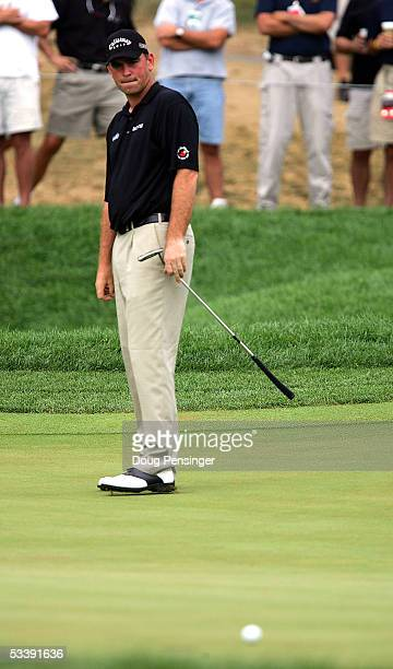 Thomas Bjorn of Denmark reacts to missing a putt on the 16th hole during the completion of the final round of the 2005 PGA Championship on August 15...