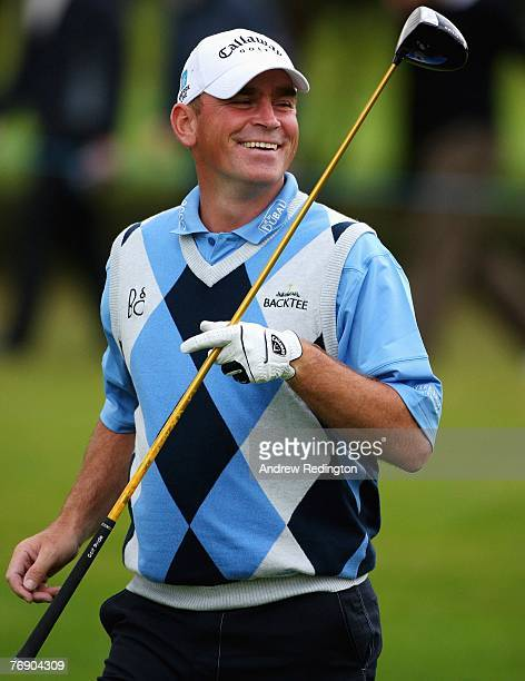 Thomas Bjorn of Denmark smiles on the 16th hole during the first round of the Quinn Direct British Masters on the Brabazon Course at The Belfry on...