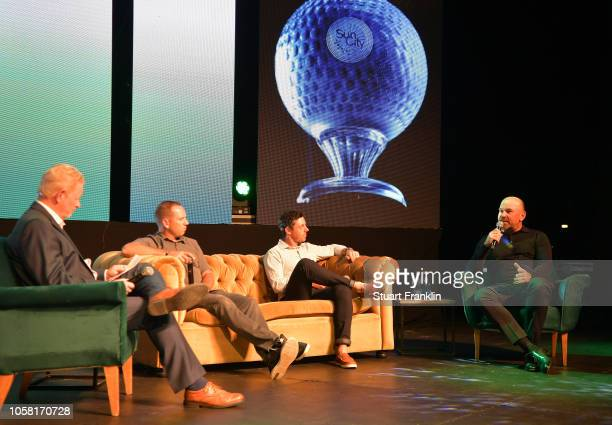 Thomas Bjorn of Denmark talks during an interview as Sergio Garcia of Spain and Rory McIlroy of Northern Ireland lister at the gala dinner prior to...