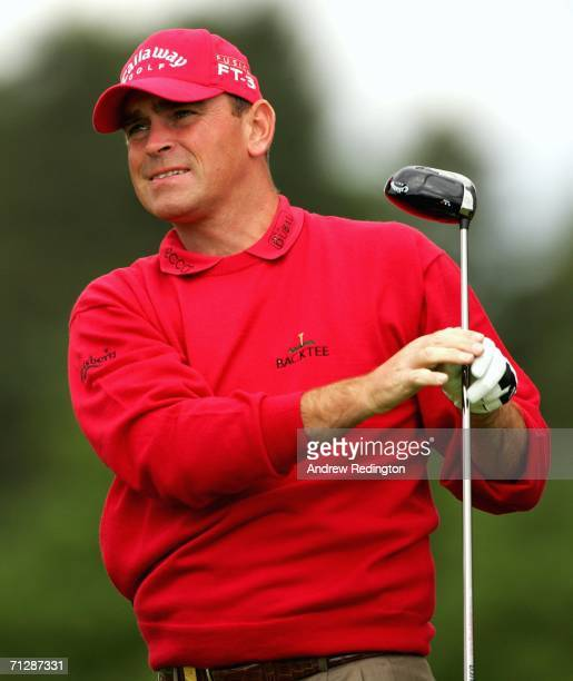 Thomas Bjorn of Denmark tees off on the second hole during the third round of The Johnnie Walker Championship on The PGA Centenary Course at...