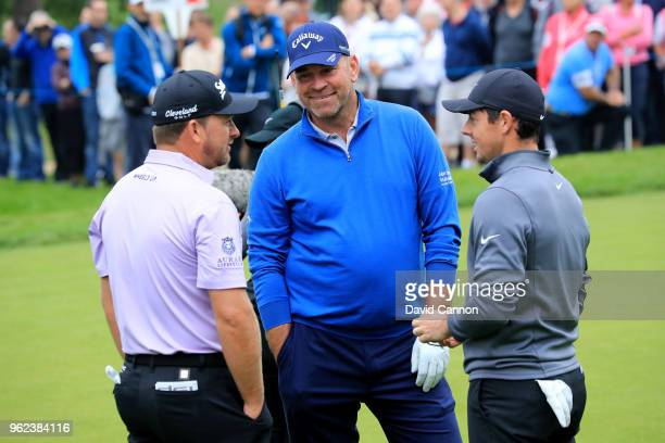 Thomas Bjorn of Denmark the 2018 European Ryder Cup captain talks to Graeme McDowell of Northern Ireland and Rory McIlroy of Northern Ireland during...