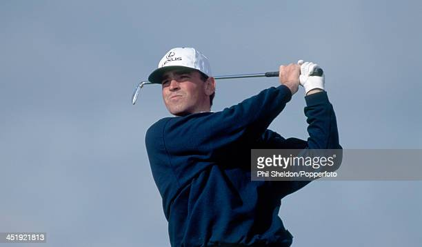 Thomas Bjorn of Denmark tracks his shot during the Benson and Hedges International Open Golf Tournament held at the Oxfordshire Golf Club in Thame...
