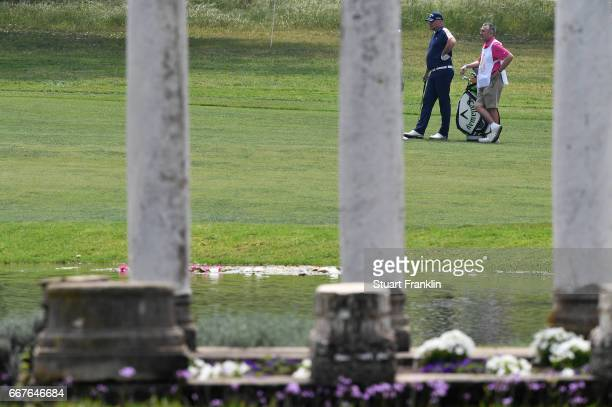 Thomas Bjorn of Denmark waits with his caddie Phil Morby during the pro am prior to the Trophee Hassan II at Royal Golf Dar Es Salam on April 12 2017...