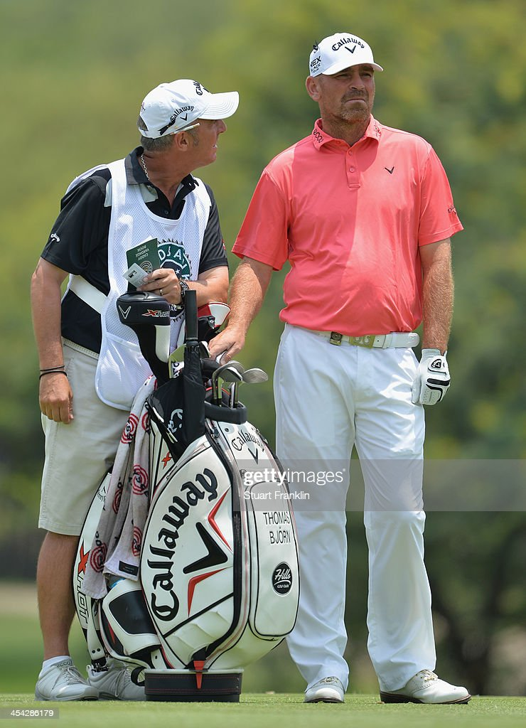 Thomas Bjorn of Denmark with his caddie Phil Morby during the final round of the Nedbank Golf Challenge at Gary Player CC on December 8, 2013 in Sun City, South Africa.