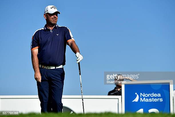 Thomas Bjorn of Norway watches his tee shot on the 12th hole during the second round on day two of the Nordea Masters at Bro Hof Slott Golf Club on...