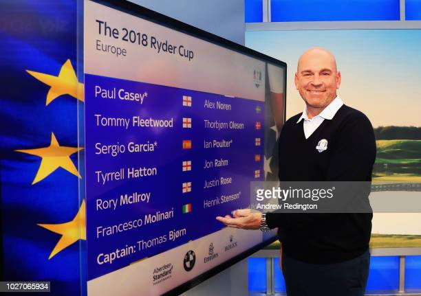 Thomas Bjorn points to a screen with the names of the 12 players during the Ryder Cup Team Europe Wild Card Selection Announcement on September 5...