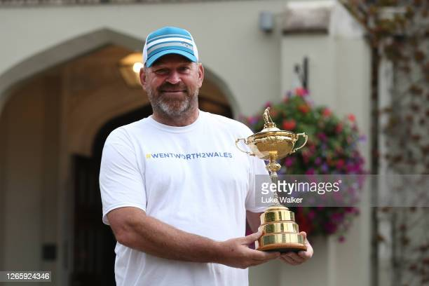 Thomas Bjorn poses with the Ryder Cup Trophy before starting the Walk From #Wentworth2Wales in aid of UNICEF & The Golf Foundation at Wentworth Golf...