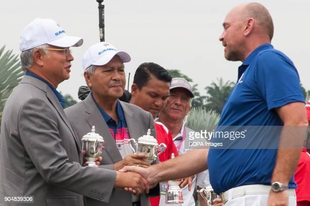 Thomas Bjorn seen receiving a ceremonial gift from the Malaysia Prime Minister Najib Razak EurAsia Cup is a biennial men professional team golf...