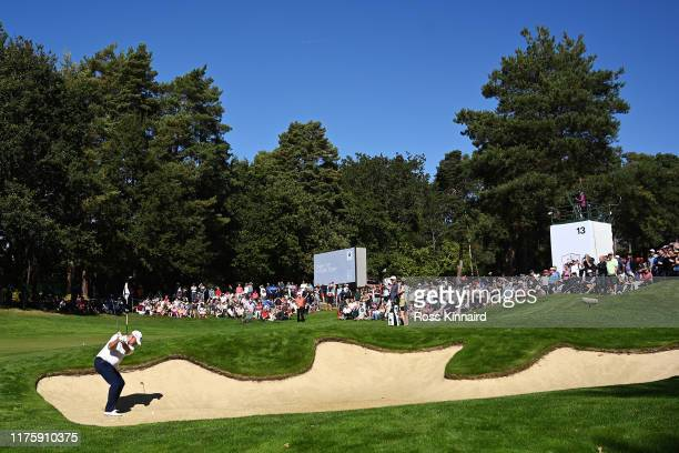 Thomas Bjørn of Denmark plays a shot out of the bunker on the 13th hole during Day Two of the BMW PGA Championship at Wentworth Golf Club on...