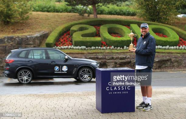 Thomas Bjørn, Team Europe's winning captain at the 2018 Ryder Cup, holds the Ryder Cup trophy after completing his 130mile four-day charity walk from...