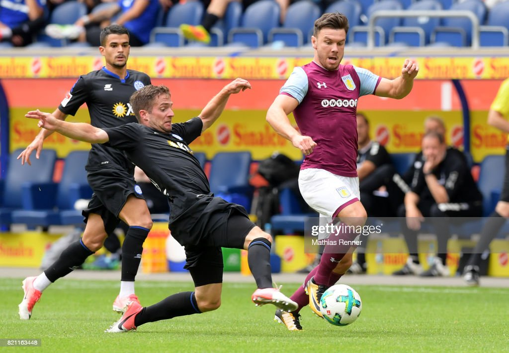 Thomas Blomeyer of MSV Duisburg and Scott Hogan of Aston Villa during the game between Aston Villa and the MSV Duisburg on July 23, 2017 in Duisburg, Germany.
