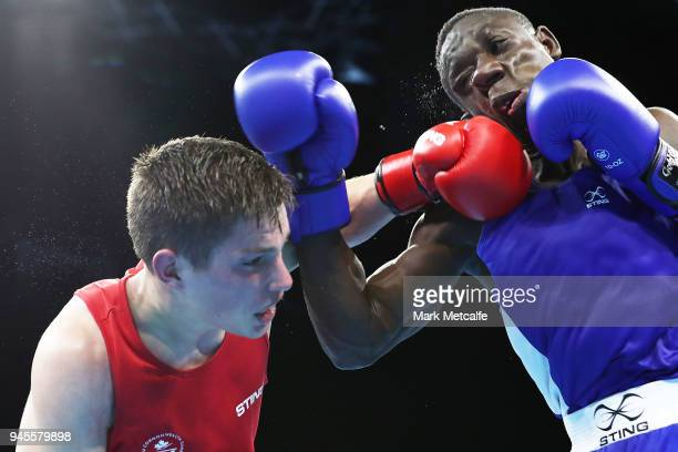 Thomas Blumenfeld of Canada and Jessie Lartey of Ghana compete in their Men's Light Welter 64kg Semifinal bout during Boxing on day nine of the Gold...