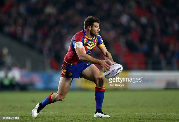 Thomas Bosc of Catalans Dragons spins the ball out during the First Utility Super League match between St Helens and Catalans Dragons at Langtree...