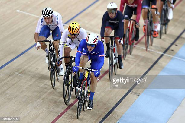 Thomas Boudat of France, Fernando Gaviria Rendon of Colombia and Elia Viviani of Italy competes in the Cycling Track Men's Omnium Points Race 6\6 on...