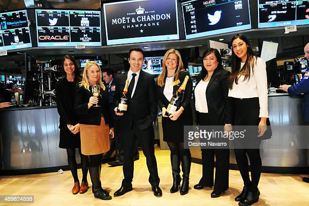 Thomas Bouleuc Vice President of Moet Chandon USA rings the closing bell at New York Stock Exchange on December 31 2013 in New York City