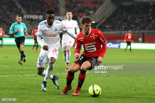 Thomas Brandon of Rennes and Bouna Sarr of Marseille during the Ligue 1 match between Rennes and Marseille at Roazhon Park on January 13 2018 in...