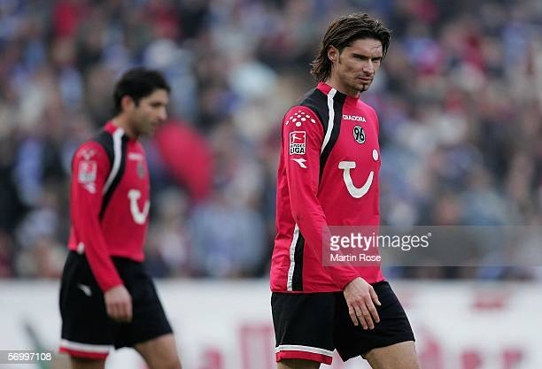 Thomas Brdaic and Vahid Hashemian of Hannover look dejected after the Bundesliga match between Hanover 96 and FC Schalke 04 at the AWD Arena on March...
