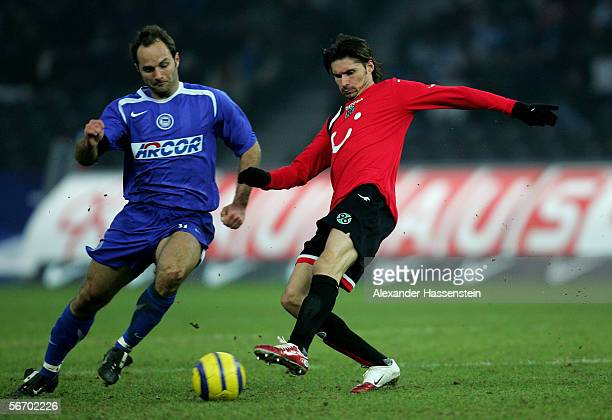 Thomas Brdaric of Hanover challenges for the ball with Dick van Burik of Berlin during the Bundesliga match between Hertha BSC Berlin and Hanover 96...