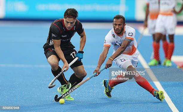 Thomas Briels of Belgium and Sunil Sowmarpet of India during the FIH Mens Hero Hockey Champions Trophy match between Belgium and India at Queen...