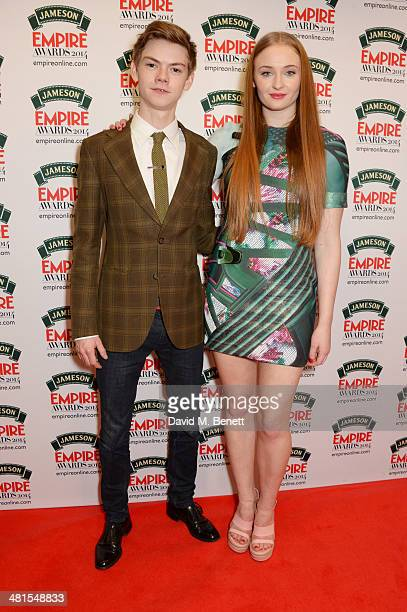 Thomas Brodie-Sangster and Sophie Turner pose in the press room at the Jameson Empire Awards 2014 at The Grosvenor House Hotel on March 30, 2014 in...
