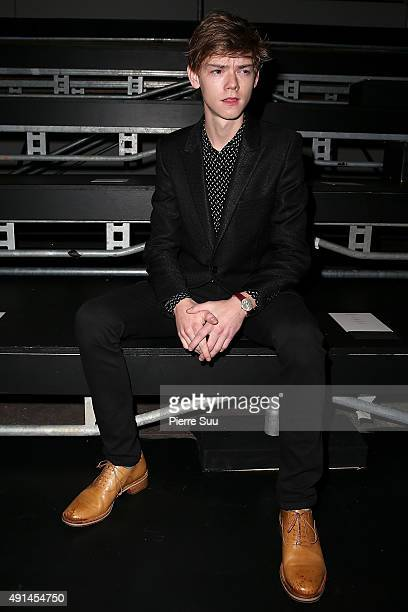 Thomas BrodieSangster attends the Saint Laurent show as part of the Paris Fashion Week Womenswear Spring/Summer 2016 on October 5 2015 in Paris France