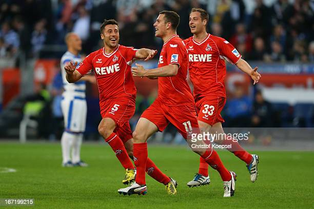 Thomas Broeker of Koeln celebrates the first goal with Dominic Maroh and Matthias Lehmann of Koeln during the Second Bundesliga match between MSV...