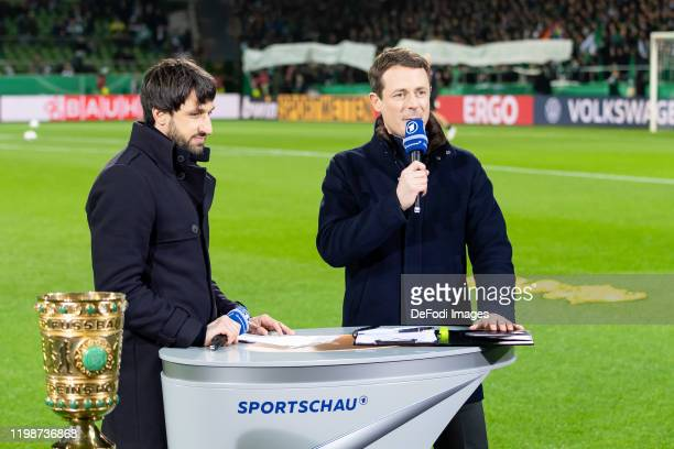 Thomas Broich and Alexander Bommes looks on prior to the DFB Cup round of sixteen match between SV Werder Bremen and Borussia Dortmund at Wohninvest...