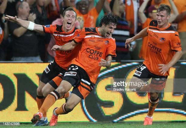 Thomas Broich Matthew Smith and Nick Fitzgerald celebrate a goal by Besart Berisha of the Roar during the 2012 ALeague Grand Final match between the...