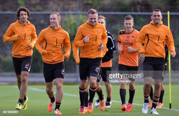 Thomas Broich Matthew Smith Besart Berisha Matthew McKay and Jade North warm up during a Brisbane Roar ALeague training session at Ballymore Stadium...