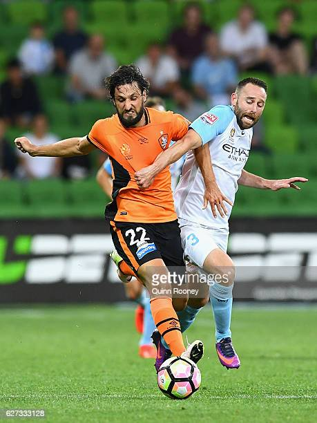 Thomas Broich of Brisbane Roar and Joshua Rose of the City compete for the ball during the round nine ALeague match between Melbourne City FC and the...