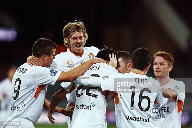 Thomas Broich of Brisbane Roar is congratulated by teammates after scoring a goal during the ALeague Elimination Final match between Adelaide United...