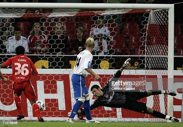 Thomas Broich of Cologne scores the second goal and goalkeeper David Knight of Middlesbrough and Andrew Davies are chanceless during the friendly...