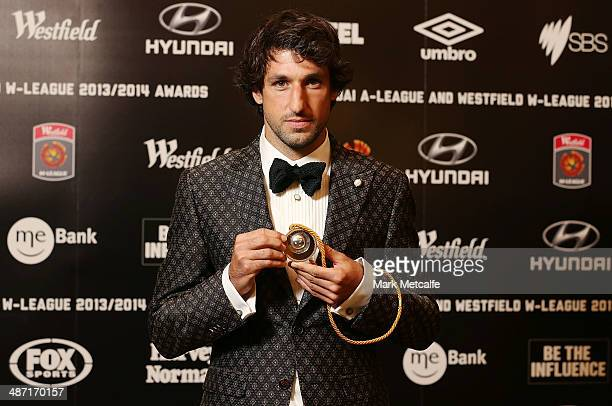 Thomas Broich of the Brisbane Roar poses with the Johnny Warren Medal as the Hyundai ALeague Players Player of the Year Award winner at the FFA...