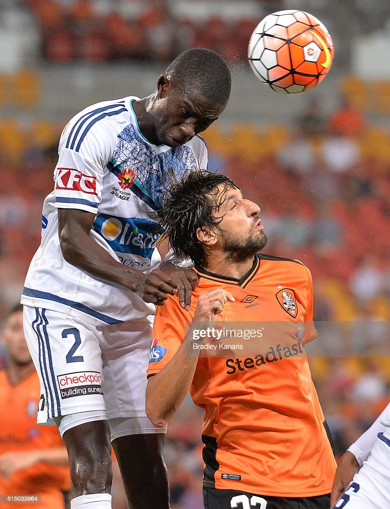 Thomas Broich of the Roar and Jason Geria of the Victory challenge for the ball during the round 23 A-League match between the Brisbane Roar and Melbourne Victory at Suncorp Stadium on March 12, 2016 in Brisbane, Australia.