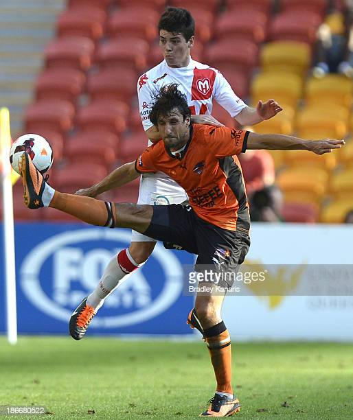 Thomas Broich of the Roar and Jeremy Walker of the Heart challenge for the ball during the round four ALeague match between Brisbane Roar and the...