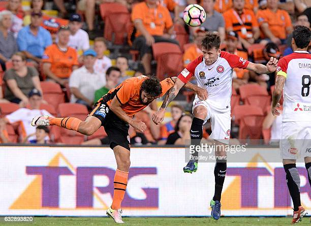 Thomas Broich of the Roar and Shannon Cole of the Wanderers challenge for the ball during the round 17 ALeague match between the Brisbane Roar and...