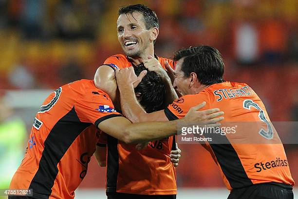 Thomas Broich of the Roar celebrates a goal with Liam Miller and Shane Stefanutto during the round 21 ALeague match between Brisbane Roar and Perth...