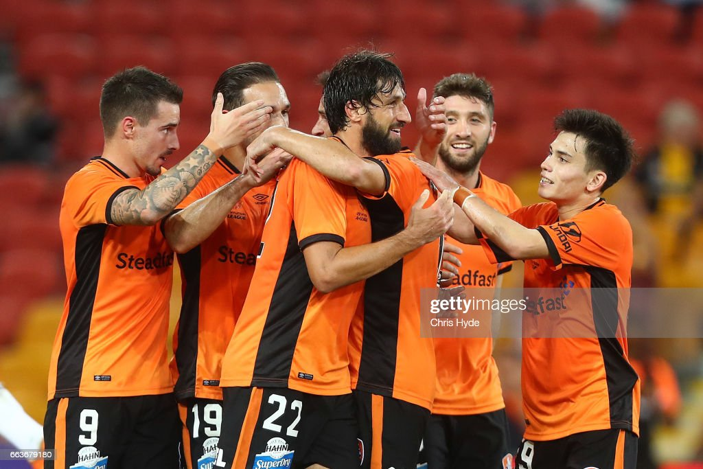 Thomas Broich of the Roar celebrates a goal with team mates during the round 25 A-League match between the Brisbane Roar and the Central Coast Mariners at Suncorp Stadium on April 2, 2017 in Brisbane, Australia.