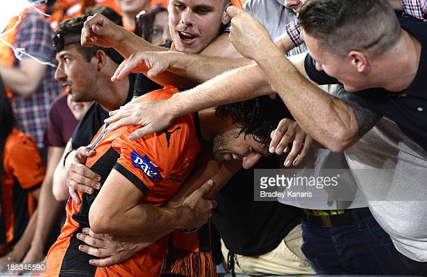 Thomas Broich of the Roar celebrates victory with fans after the round two ALeague match between Brisbane Roar and Sydney FC at Suncorp Stadium on...