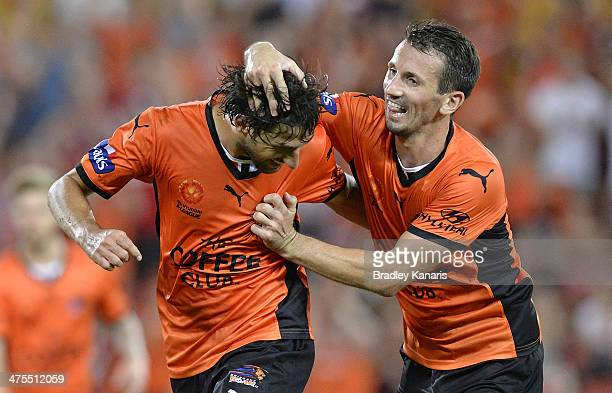 Thomas Broich of the Roar celebrates with team mate Liam Miller after scoring a goal during the round 21 ALeague match between Brisbane Roar and...