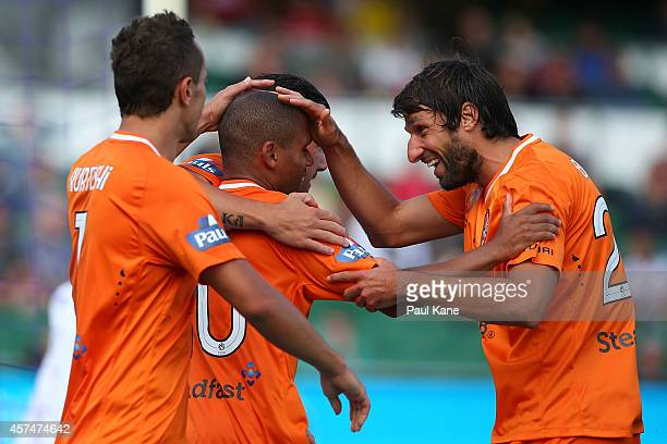 Thomas Broich of the Roar congratulates Henrique De Silva after scoring a goal during the round two ALeague match between the Perth Glory and...