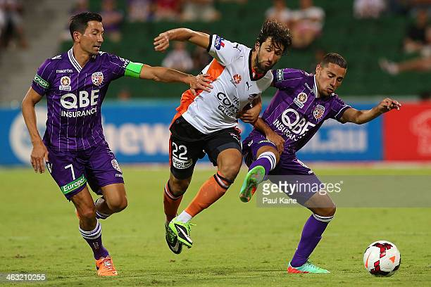 Thomas Broich of the Roar contest for the ball against Jacob Burns and Adrian Zahra of the Glory during the round 15 ALeague match between Perth...
