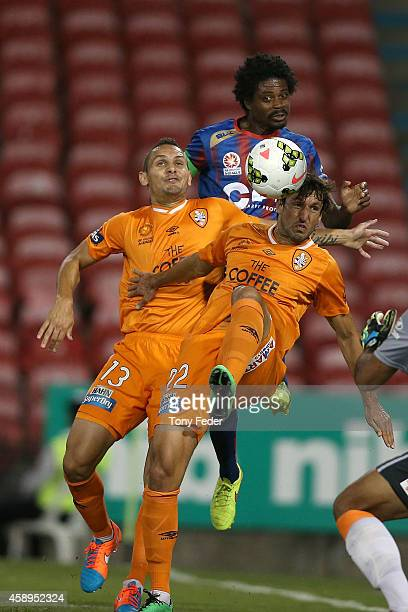 Thomas Broich of the Roar contests the ball with Kew Jaliens of the Jets during the round six ALeague match between the Newcastle Jets and Brisbane...