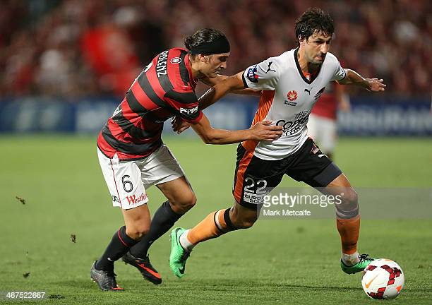 Thomas Broich of the Roar is challenged by Jerome Polenz of the Wanderers during the round 18 ALeague match between the Western Sydney Wanderers and...