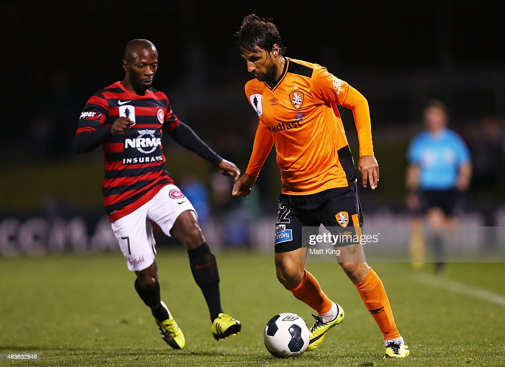 Thomas Broich of the Roar is challenged by Romeo Castelen of the Wanderers during the FFA Cup match between Western Sydney Wanderers and Brisbane Roar at Pepper Stadium on August 11, 2015 in Sydney, Australia.