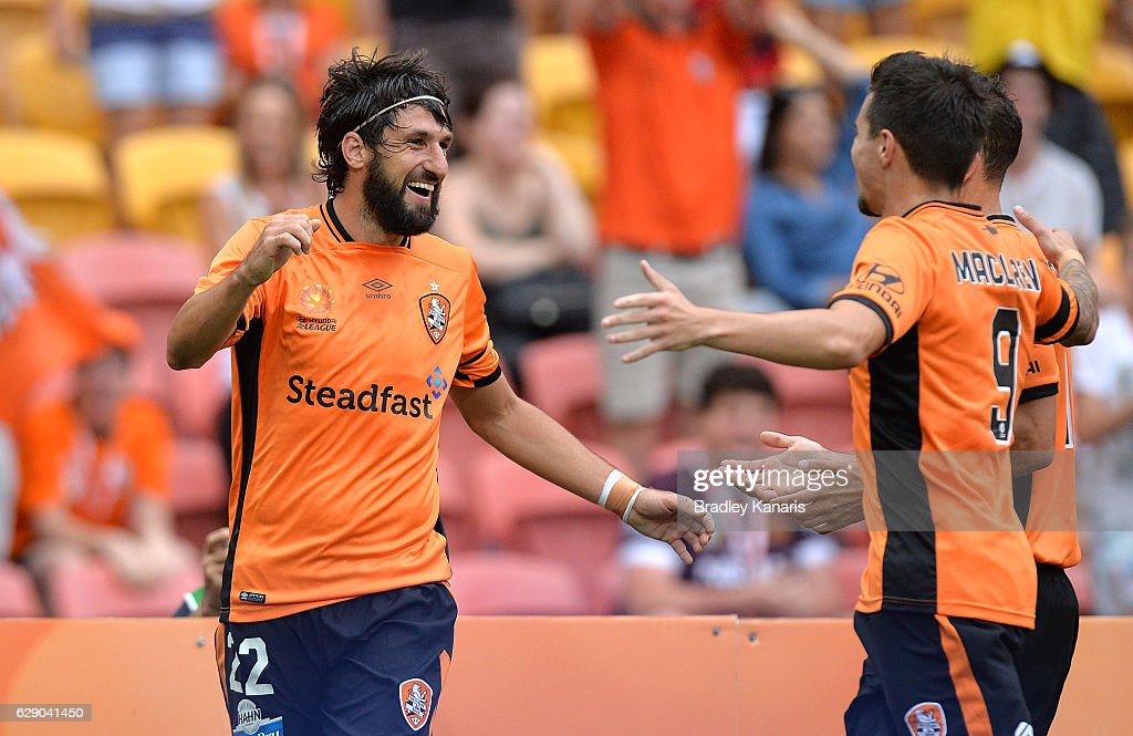 Thomas Broich of the Roar is congratulated by team mates after scoring a goal during the round 10 A-League match between the Brisbane Roar and Adelaide United at Suncorp Stadium on December 11, 2016 in Brisbane, Australia.