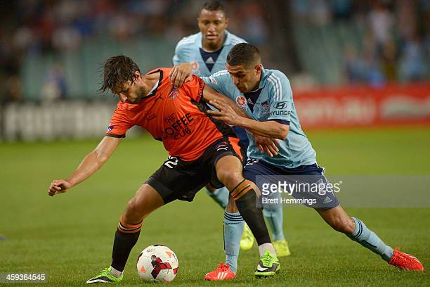 Thomas Broich of the Roar is tackled by Ali Abbas of Sydney during the round 12 ALeague match between Sydney FC and Brisbane Roar at Allianz Stadium...