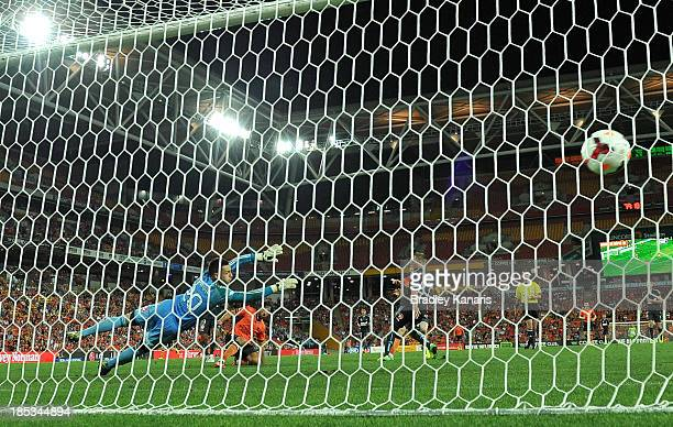 Thomas Broich of the Roar scores a goal as Ivan Necevski of Sydney dives in an attempt to save the goal during the round two ALeague match between...