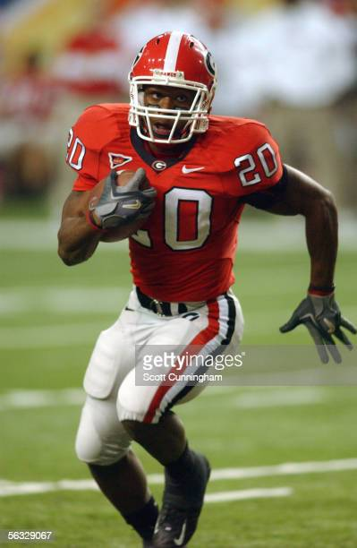 Thomas Brown of the Georgia Bulldogs runs against the LSU Tigers during the 2005 SEC Championship Game on December 3 2005 at the Georgia Dome in...