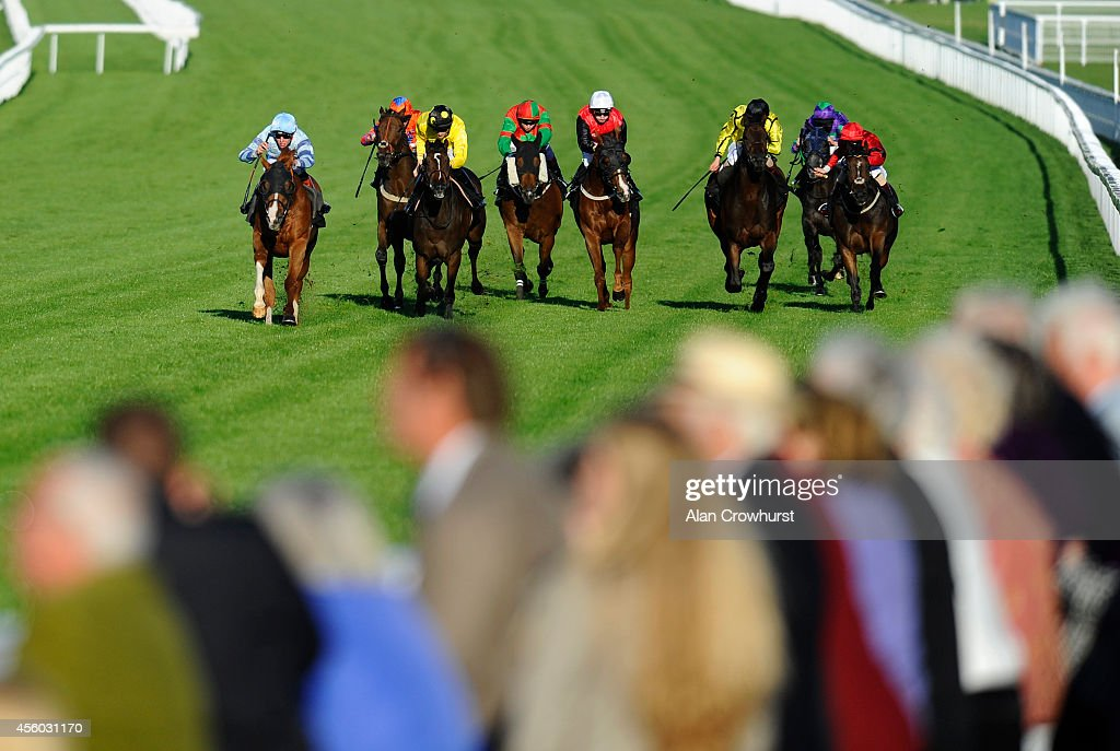 Thomas Brown riding Dishy Guru (L) win The Clancy Docwra Apprentice Stakes at Goodwood racecourse on September 24, 2014 in Chichester, England.